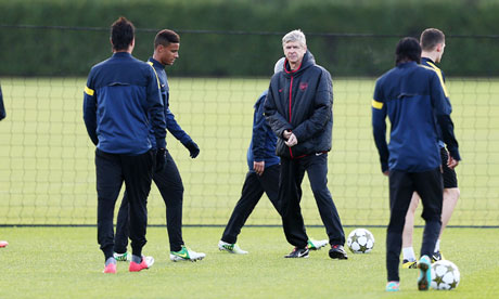Arsène Wenger, centre, with his Arsenal players ahead of their Champions League game with Olympiakos