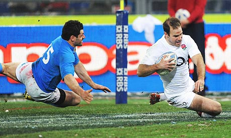 England's Charlie Hodgson eludes Andrea Masi of Italy to score a try in the Six Nation