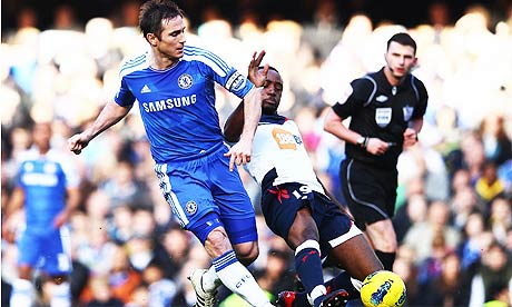 Chelsea's Frank Lampard holds off the challenge of Nigel Reo-Coker of Bolton Wanderers