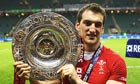Wales's Sam Warburton with the triple crown trophy after a 19-12 win against England at Twickenham
