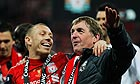 Craig Bellamy, left, and Liverpool's manager Kenny Dalglish celebrate the club's Carling Cup win