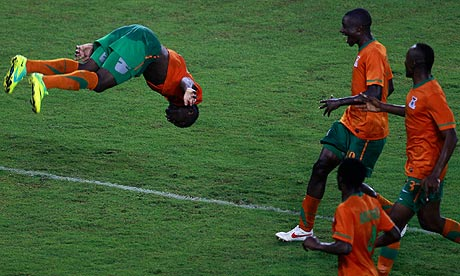 Emmanuel Mayuka, left, celebrates after scoring Zambia's winning goal against Ghana