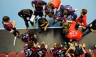 Dragan Djukic, centre, addresses Britain's men's handball team during a world championship qualifier