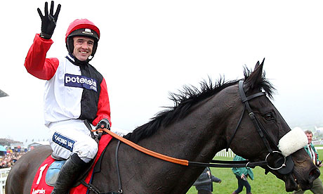 Ruby Walsh celebrates after riding Big Buck's to victory