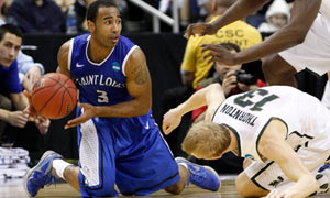 Saint Louis' Kwamain Mitchell vs Michigan State's Austin Thornton. March Madness