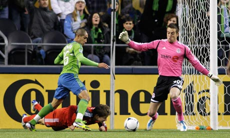 David Estrada scores for Seattle Sounders past Toronto FC's Milos Kocic. MLS