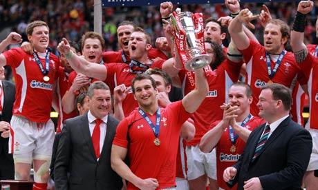 Sam Warburton struggles to lift the Six Nations Trophy