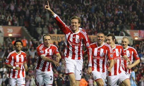 Peter Crouch celebrates his spectacular volleyed goal for Stoke against Manchester City