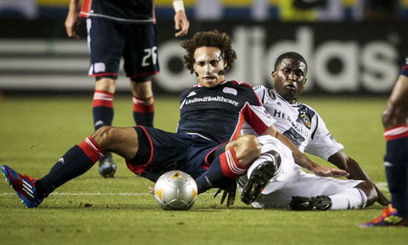 LA Galaxy's Edson Buddle and New England Revolution's Kevin Alston