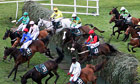 Synnchronised falls at Becher's Brook during the Grand National