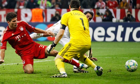 Mario Gomez pokes the ball past Iker Casillas to give Bayern Munich a 2-1 win against Real Madrid