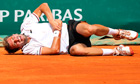 Julien Benneteau reacts after a fall during the Monte Carlo Masters