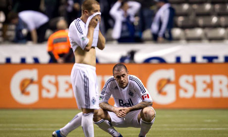 Vancouver Whitecaps' Eric Hassli and Jordan Harvey