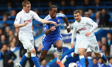 Didier Drogba of Chelsea is challenged by James McCarthy