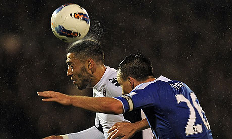 Fulham's Clint Dempsey and Chelsea's John Terry challenge for a high ball