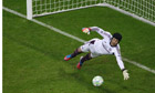 Petr Cech dives to keep out  Bastian Schweinsteiger's penalty
