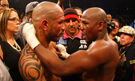 Miguel Cotto hugs Floyd Mayweather Jr.