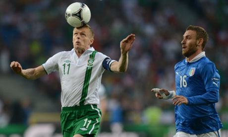 Irish midfielder Damien Duff controls the ball