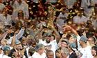 LeBron James of the Miami Heat holds the NBA championship trophy