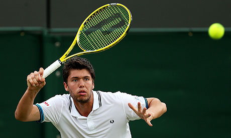 Oliver Golding plays an awkward shot in his defeat to Igor Andreev at Wimbledon