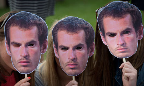 Tennis fans pose for pictures with masks of Andy Murray