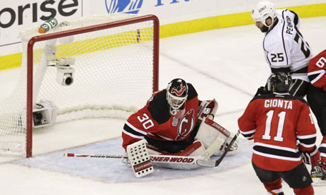The puck flies into the net for the winning goal by Los Angeles Kings