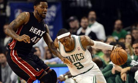 Boston Celtics guard Rajon Rondo drives past Miami Heat forward Udonis Haslem