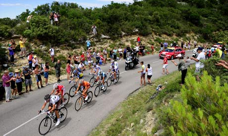 Fans cheer on the leading men during stage 13