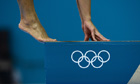 An athlete dives during a diving training session at the Aquatics Centre