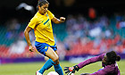 Cristiane goes past Annette Ngo Ndom to score Brazil's fourth goal against Cameroon