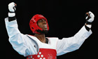 Lutalo Muhammad celebrates winning bronze for Team GB in the Men's 80kg taekwondo category