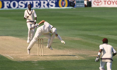 Ian Botham attempts to avoid a Curtly Ambrose bouncer but only succeeds in hitting his own wicket