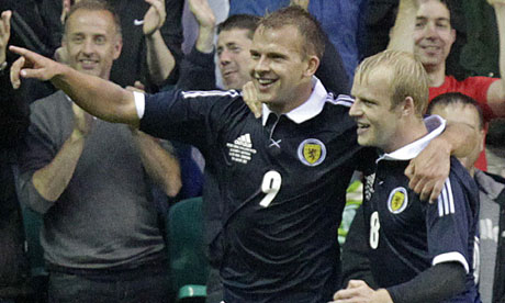 Jordan Rhodes (left) celebrates his goal for Scotland against Australia with Steven Naismith