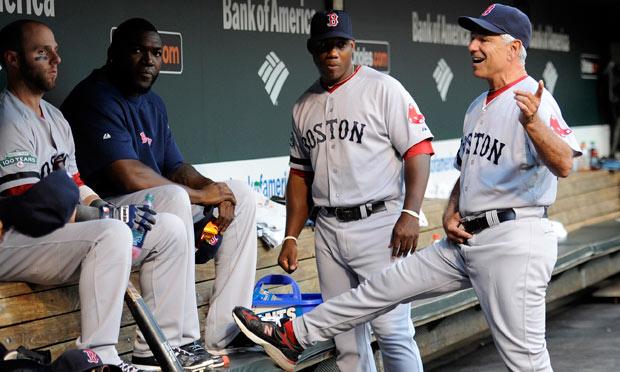 Boston Red Sox manager Bobby Valentine, right, talks with Dustin Pedroia, David Ortiz and Alex Ochoa