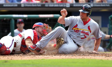 Matt Holliday of the St Louis Cardinals slides under the tag of Philadelphia Phillies' Erik Kratz