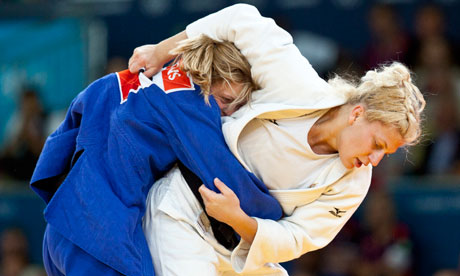 Kayla Harrison competes with Britain's Gemma Gibbons