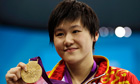 China's Ye Shiwen poses with her gold medal