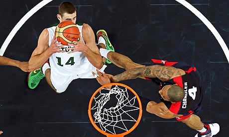 Lithuania's Jonas Valanciunas grabs a rebound from the USA's Tyson Chandler in Olympic basketball