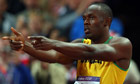 Usain Bolt celebrates his 100m triumph