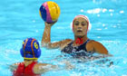 Brenda Villa of the USA looks to pass during her team's gold-medal match victory over Spain