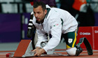 South Africa's Oscar Pistorius adjusts his starting blo