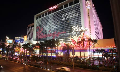 Cars drive past the Flamingo Hotel in Las Vegas
