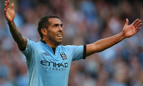 Carlos Tevez celebrates after scoring in Manchester City's 3-1 victory against Queens Park Rangers