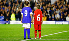 Children wearing Everton and Liverpool kits bearing the number 96