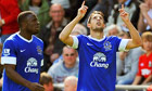 Everton's Kevin Mirallas and Victor Anichebe celebrate