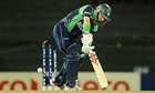 Ireland's William Porterfield is bowled by West Indies' Fidel Edwards for 0