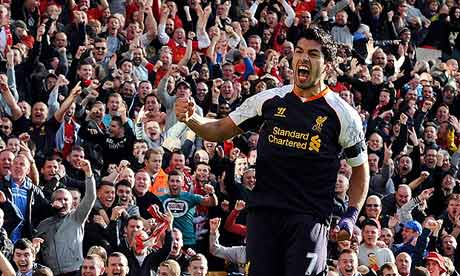 Luis Suárez celebrates in front of the Liverpool supporters after scoring against Norwich