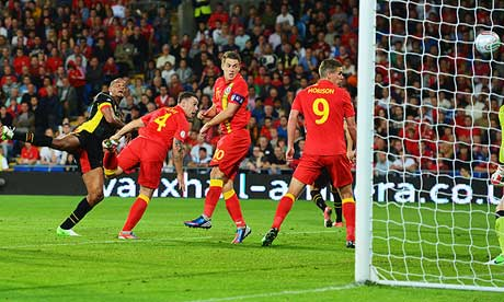 Vincent Kompany stretches to head Belgium into the lead against Wales in Cardiff