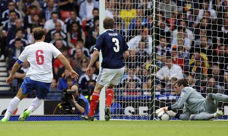 Scotland's Allan McGregor saves from Serbia's Branislav Ivanovic in the World Cup 2014 qualifier