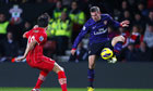 Lukas Podolski, right, looks to retain possession under pressure from Southampton's Jack Cork